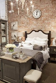 Fabulous in so many ways. The brick. The chandelier. The pillows!                                                                                                                                                      More