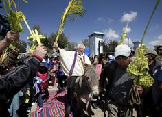 A priest on a donkey in Bolivia. | 16 Ways To Celebrate Holy Week Around The World