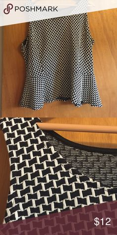 Lane Bryant black/white blouse size 18/20 Lane Bryant black/white patterned sleeveless blouse. Material is a slightly stretchy polyester blend. Size 18/20. Discounted because I cut out all my tags.  Great worn under a cardigan or blazer. Lane Bryant Tops Blouses