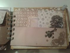 Pocket page with journalling tags by project lie. A charm added by using a small hole punch and a jump ring.