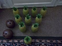 pineapple bowling! Cute and fun for little kids!! But a cheap way would be to fill soda liters with something semi heavy and paint the pineapples on with like green paper sticking on the top