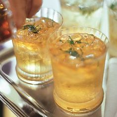 Mint Ginger Ale - 2 Tbs. packed fresh mint leaves, julienned  1 tsp. sugar  Ice cubes as needed  2 bottles (each 1 quart) ginger ale or tonic water  Bourbon, to taste (optional)