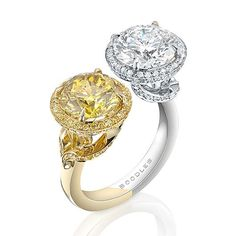 This very rare vivid Zimi yellow diamond of over 3 carats is counterbalanced with an exceptional white round-brilliant cut diamond. Exquisitely framed within a halo of diamonds, both are set in a beautiful combination of platinum and yellow gold.