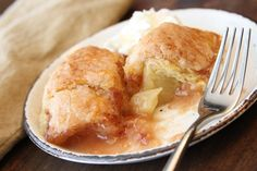 Apple Dumplings - Try this recipe with 2 trays of Dippin' Stix Apples with Caramel. Pour the caramel over the dumplings just before serving. Apple Recipes, Fall Recipes, Gin Recipes, Just Desserts, Dessert Recipes, Apple Desserts, Easy Apple Dumplings, Peach Dumplings, Cooked Apples