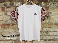 This is our Floral Sleeve Tee - Available at superiorbelief.bigcartel.com