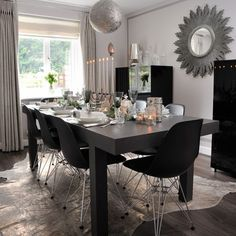 Contemporary Christmas dining room with monochrome table setting | Budget Christmas table ideas | housetohome.co.uk