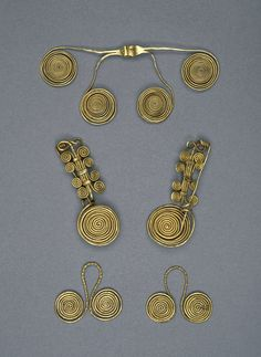 Gold brooch: one of a pair; series of spiral-ended wires clasped by strips to a bow of twisted wire; pin, hinge and catch-plate all form single strand.