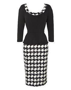 Houndstooth: A Traditional Woven pattern for Wool. Often done in white with a strong color contrast check. Typical shape of the pattern is now interpreted as a weaven in many fibers and frequently printed on many base goods.