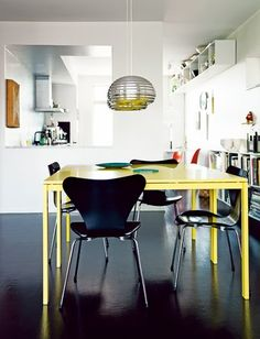 A home in Malmö, Sweden. Photo by Petra Bindel for Swedish ELLE Decor. The table is the Melltorp dining table from Ikea painted in yellow. Black Furniture, Colorful Furniture, Dining Room Inspiration, Interior Inspiration, Color Inspiration, Yellow Table, Yellow Desk, Sweet Home, Black Floor