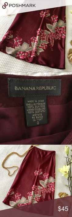 """Banana Republic Silk Skirt Words don't really do this beautiful, long silk skirt justice (how I wish it still fit me!).  Burgundy color with beautiful pinkish, greenish, grey floral motif in 100% silk.   Very versatile—would fit in at work and transition to a night affair beautifully.  Lined with hidden side zipper.  Only worn once (sigh) so in excellent condition. Pet free and smoke free home. Size 0.  30"""" long.  [Earrings also for sale] Banana Republic Skirts Maxi"""