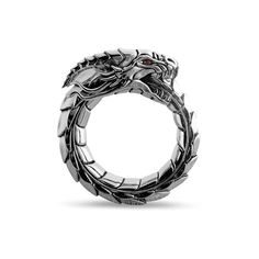 <ul> <li>Men's Silver Dragon Ring.</li> <li>2 blood-red garnets for eyes.</li> <li>Design features a Silver Dragon, depicted as the Ouroboros.</li> <li>12mm wide.</li> <li>Unique men's ring, designed and handcrafted in the United States. </li> <li>Nick's Notes: The Dragon's ferocity is legendary, its power unmatched. It rules land, sea and sky without contestation. Though,...