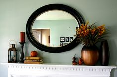 Simple Fall Mantel - small pumpkin, bronze vases, stack of books