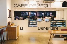 Café de Seoul: Unit 12, 2/F One Archer's Building, Manila, Philippines. Being a coffee shop that caters to both the Korean and Filipino palates, Café de Seoul has an extensive array of coffee drinks to choose from. While most modern cafés in Metro Manila tend to take a minimalist approach in their interior design choices, Café de Seoul has managed to find a balance among simplicity, being quirky, and imaginative.
