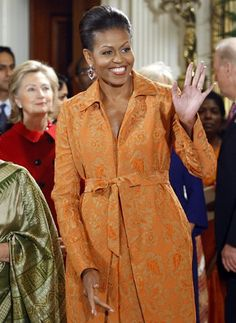 Daring Color  We haven't seen many first ladies rock bright colors, but Michelle Obama doesn't shy away from the bold. During a news conference and state dinner at the White House, Mrs. O showed off this tangerine-hued brocade dress and coat by Isaac Mizrahi.