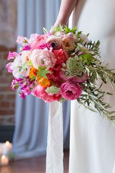 Modern bright pink wedding bouquet with pop of orange ranunculus   Anna Pretorius Photography & The Stache Photography