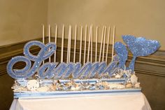 Under-the-Sea theme candlelighting, with mermaid silhouette and seashells, by Glitter Events – NJ Event Planners | Sammi's Sweet 16