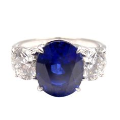GRAFF Sapphire Diamond Three-Stone Platinum Ring   From a unique collection of vintage cocktail rings at http://www.1stdibs.com/jewelry/rings/cocktail-rings/
