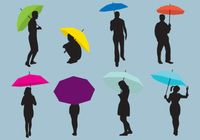 Woman And Man Umbrellas Silhouettes