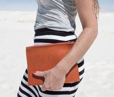 camel clutch + striped skirt.