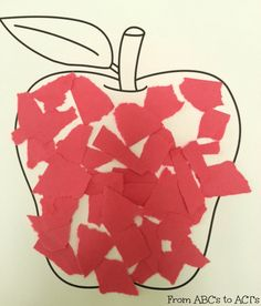 Ripping red paper and gluing to an apple page for red week in tot ...