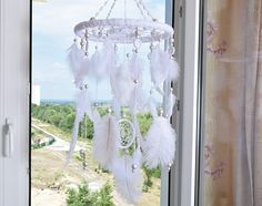 "White Baby Mobiles Nursery Decor Dream Catcher Nursery Mobile Wedding Accessories Wall decor Mobile Bedroom Nursery Boho Kids Girl Boy A Dream catcher, literally translated as a ""dream snare,"" originated from Native American culture… Mothers and grandmothers traditionally weaved"