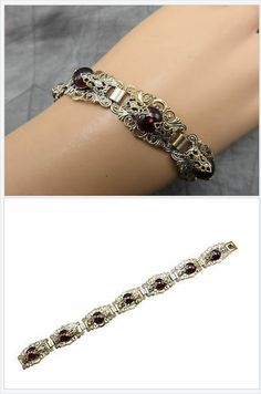 Intricate bands of duo tone metals interlace to form a flattering wrist piece with standout style that encompasses the graceful beauty of ruby as an addition to your attire. #stuff4uand4u