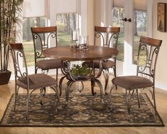 Plentywood 5-Piece Round Dining Table Set by Signature Design by Ashley   Part of the Plentywood Collection Sku: D313-15B+T+4x01 Store Availability: In Stock and On Display Compare At Price: $1,059.94 Sale Price: $599.94