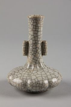 Vase Period:     Qing dynasty (1644–1911) Date:     19th century Culture:     China Medium:     Porcelain with crackled glaze (Gê type) Dimensions:     H. 5 in. (12.7 cm); Diam. 4 in. (10.2 cm) The Metropolitan Museum of Art.