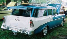 "1956 Chevy 210 Beauville wagon; the only four-door, nine-passenger station wagon in the '56 Chevy lineup...but this one hauls more than just kids and cargo! Dig the reverse wheels, pin striping, and the surfboard up top! (Wouldn't mind haulin' the bongos in this one, man!) This car, as well as the roadster pickup, '57 Corvette and GTO, were seen at the ""Patriots in the Park"" car show in Granite City, Illinois!"
