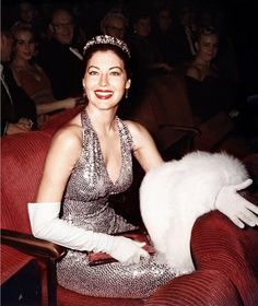 Ava Gardner wears a tiara and a evening gown as she sits in her seat in the audience of the Academy Awards ceremony which was held at the RKO Pantages Theatre on April 4, 1960, in Los Angeles, California.