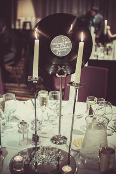 Classic table setting with vintage record and candles as the centerpiece