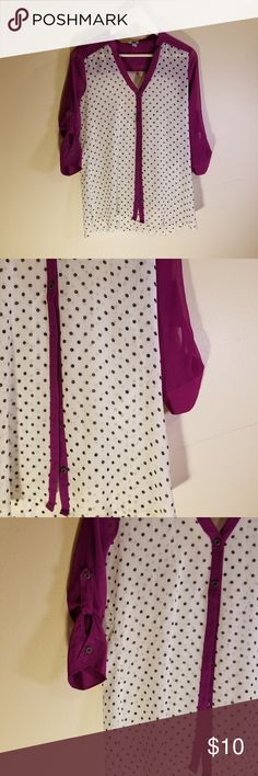 Vanity polka dot polyester top Vanity polka dot polyester top  In good condition.  No rips or stains. 100% polyester.   EVERYTHING MUST GO!!!!!!!🌻check out my closet! HUNDREDS or available items in a VARIETY of sizes 🌻 add to BUNDLE to receive a private discount 🌻 BUNDLE to save on shipping! 🌻 Vanity Tops Blouses