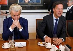 Dutch Prime Minister Mark Rutte (right) and far-right politician Geert Wilders (left) meet in The Hague on Thursday. YVES HERMAN / Reuters
