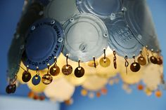 recycled tin can lid lampshade...could paint each lid a different color or spray them all the same...I like it!