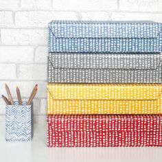 Our stylish A4 box files will brighten up any shelf or home office in these eye catching hand drawn spot prints in four colours: Red, Blue, Grey and Mustard. All our beautiful handmade stationery and storage products are produced in an eco-friendly way, from 100% recycled materials.