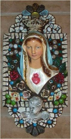 """Our Blessed Mother"" Retablo . Love this use of a head from a statue (I am guessing here) perhaps broken, but salvaged and added to a lovely mosaic."
