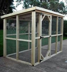 A nice and simple design for a catio. Switch the door to the other side and place against wall with a cat door. Add a couple climbing perches and voila!