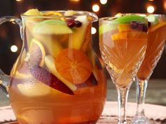 Simply Holiday Sangria Recipe - A pitcher of Holiday Sangria will add instant cheer to your holiday table this year. Make your own with this easy sangria recipe. Winter Drinks, Summer Drinks, Cocktail Drinks, Fun Drinks, Beverages, Alcoholic Drinks, Mixed Drinks, Holiday Sangria, Holiday Drinks