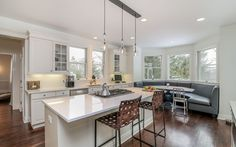 Kitchen with Caesar stone countertops, island and banquette