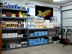 Youngtimer Organized garage system using Elfa Shelving from the container store.