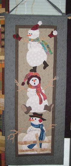 Cute little snowman table runner or wall hanging. I love the middle one's face! This is just the photo - no tutorial.
