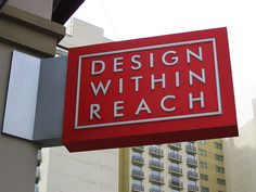 I like this metal corner mount for a blade sign....Design Within Reach Blade Sign