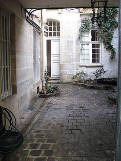 Jamie's home in Paris. Lovely exterior. [Credit Le Marais, Paris]
