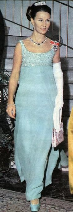 a full length image of Sonja, circa 1968, wearing the Oslofjord tiara teamed with a turquoise or  green gown