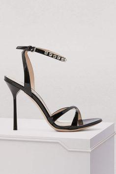 a356ea6d3cf Miu Miu Crystal sandals  The bold spirit that drives the Miu Miu fashion  house can