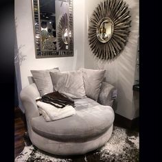 Our Cuddler Chair, Ayi Faux Cowhide Rug, Avila Mirror, and Fairmont Mirror make for a comfy nook in @newlywed143's home.