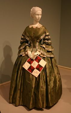 Silk dress with ribbon trim at the Wadworth Museum exhibit Colts & Quilts: The Civil War Remembered.