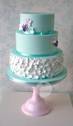 Hydrangeas on a tiffany blue three-tiered wedding cake #wedding #weddingcake…