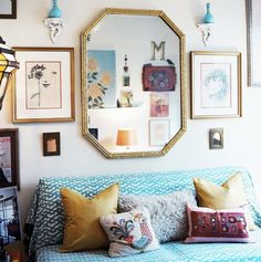 living room: bright couch cover/throw, colorful pillows, lots of wall art