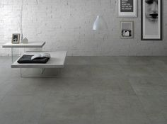 Light Grey Concrete Tiles | Concrete finds inspiration from the recovery of old buildings constructed of concrete. Crystallising this magic, it plays in a concrete effect floor suitable for contemporary spaces of living.